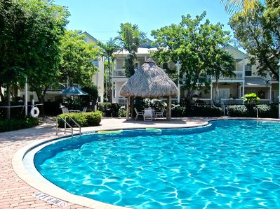 Relaxing pool area features salt water pool with tiki hut to relax the days away