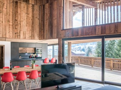 Photo for THE RED - Chalet modern and design of 250m2 with fireplace, outdoor jacuzzi, sauna and cinema room, capacity of 14