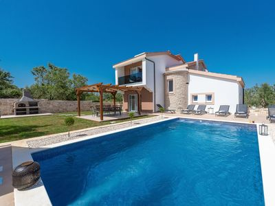 Photo for This 3-bedroom villa for up to 8 guests is located in Kraj and has a private swimming pool, air-cond
