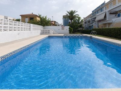 Photo for GOLDEN - Chalet with shared pool in Playa de Gandia.