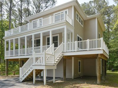 Photo for FREE ACTIVITIES!!! Gorgeous NEW CONSTRUCTION with beautiful furnishings and luxury bathrooms with showers you must experience to appreciate!   This elegant 5 bedroom, 6.5 bath home is nestled in the pines of one of Bethany?s most sought after private beach communities