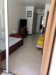 Photo for Homerez last minute deal - Nice studio with shared pool