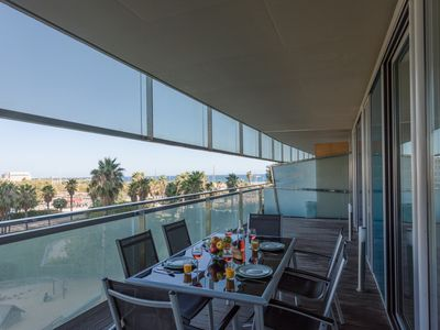 Photo for Unique Rentals - Seafront luxe with terrace and pool I