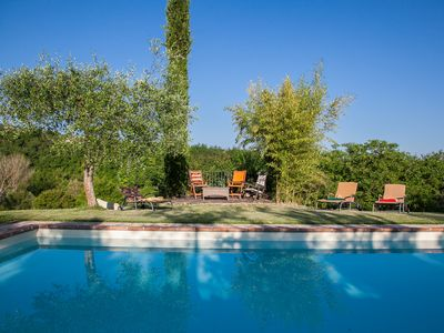 Photo for views over Tuscany, fenced heated pool, set in private estate, 10km to Tuscany