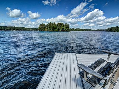 Photo for NEW LISTING! Luxurious, lakefront, cabin-style home with wet bar, dock & views
