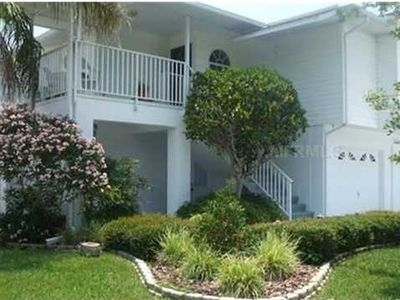 waterfront home with elevator-newer home-tropical-quiet street