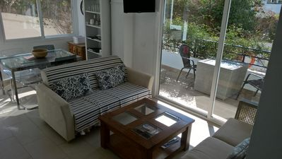 Photo for MODERN 2 BED GARDEN APARTMENT WITH FREE WI-FI. 8 MINUTES WALK TO BURRIANA BEACH