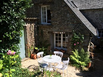 Photo for Exquisite 18th Century Millers Cottage, nr Mont St Michel