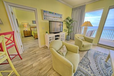 Great room with 60 in HDTV, HD-DVR, BLU-RAY, Sleeper Sofa and two swivel chairs.
