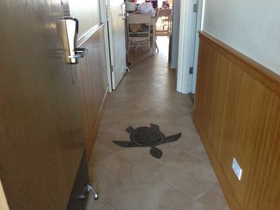 Entry way sea turtle welcomes you. A unit is ahead, Studio B unit to the right