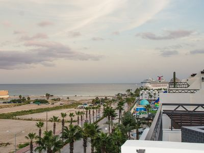 Photo for PENTHOUSE CONDO W/ 935 sq ft ROOFTOP DECK/JACUZZI -Walk to Beach & Downtown Cabo