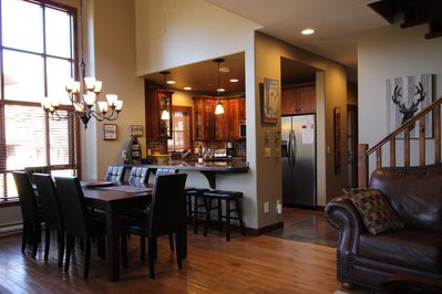 Open concept and nicely upgraded dining room, living room and kitchen