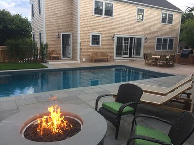 Photo for WALK TO TOWN WITH HEATED POOL home is all new