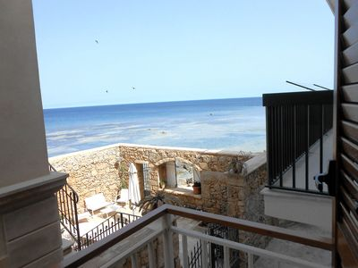 Photo for Modern seafront apartment with balcony and splendid sea view
