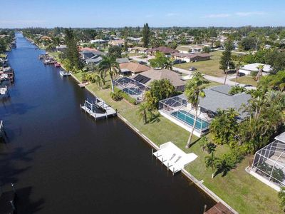 Photo for SWFL Rentals - Villa Amelia - Cozy Pool Home on Canal in SE Cape Coral Sleeps 6