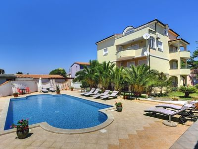 Photo for Apartment with large pool, 2 bedrooms, air conditioning, WiFi and only 700 meters to the sandy beach