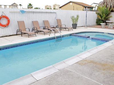 Photo for Courtyard condo with pool & close to beach!