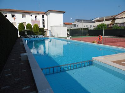 Photo for Apartment with swimming pool and tennis court