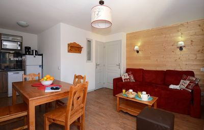 Relax in the open-concept living space which adjoins with the dining area. The lay out may vary slightly from the photos.
