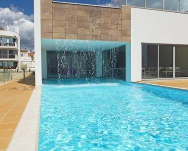 Photo for Luxury apartment with swimming pool in pedestrian Fuseta Resort, Algarve