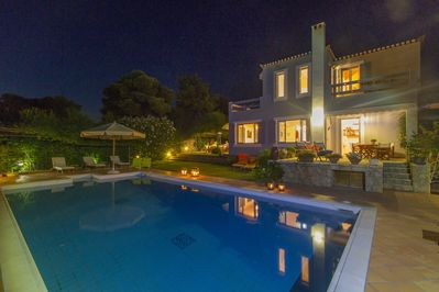 The house and pool at night