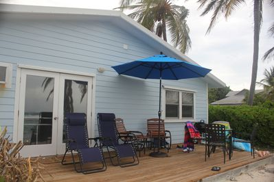 Our deck with comfortable seating and a table for eating outside.  Kayak too.