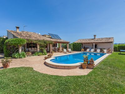 Photo for The villa has a great garden with a long rectangular pool.
