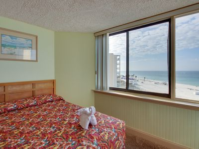 Photo for Well-stocked, waterfront beach condo w/ pool - snowbirds welcome! Couples trip!