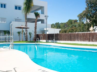 Photo for Brand new apartment, sleeps 6. With communal swimming pool, sleeps 6.