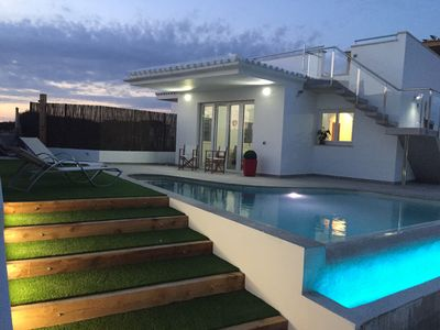 Photo for Villa in 1st line with garden, pool, roof terrace with sea views and BBQ. WIFI #