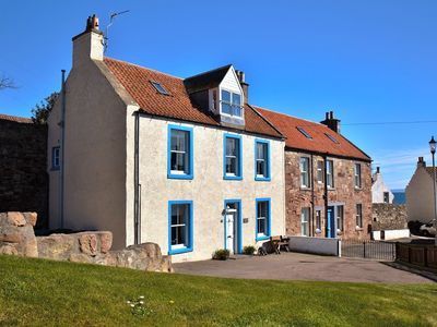 Photo for A beautiful 4 bedroomed house next to the harbour with fabulous gardens