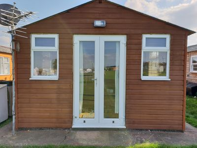 Photo for 2 Bedroom holiday Chalet, mins to the beach and amusements