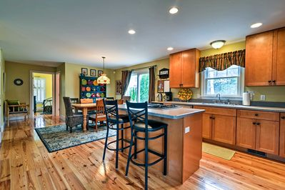 The island counter offers a great meal preparation space!