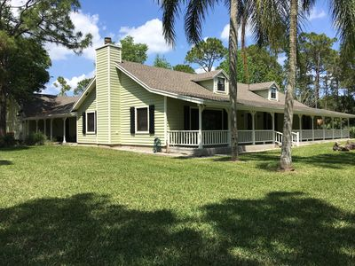 Photo for 5-Acre Farmhouse Retreat w/Pool, Pond, 10 Mins from PGA Golf, 24 Mins to Beaches