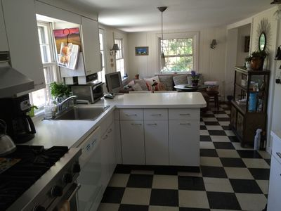 Kitchen has comfy dining area and high end appliances (Viking Stove)