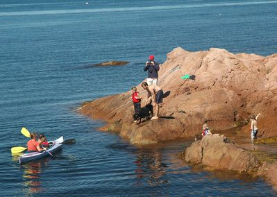 Swimming rock next to easy shore  launch site for kayaks