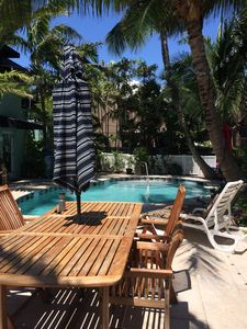 Poolside Grill, picnic table and lounge chairs
