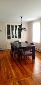 Dining room seats 6 with refinished hardwood floor.