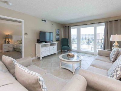 Photo for New Listing! Beachfront Condo with Partial Beach Views. Beachfront Pool and Onsite Fitness Center