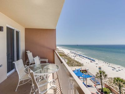 Photo for Beachfront condo w/private balcony and shared pool - steps to beach & shopping!