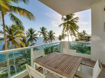 Photo for Ocean-facing apartment w/ large balcony & shared pool - steps to beach!