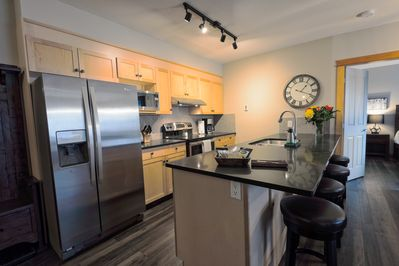 New stainless steel appliances, whisper quiet dishwasher and sitting area.