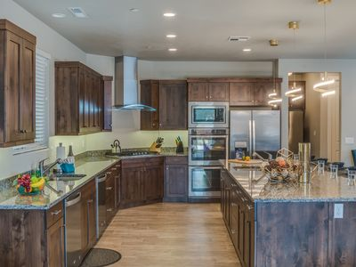 Photo for 89| Sleeps 30 + Theater + Hot Tub + Game Room + 7 Master Suites