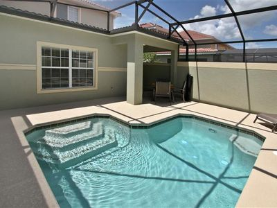 Photo for 5 bedroom townhome with a private pool in a gated community