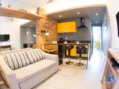 Photo for Loft Copacabana sea view, 100% air conditioned and garage! Award-winning architect!