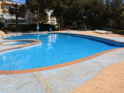 Photo for Apartment with pool and terrace overlooking the sea