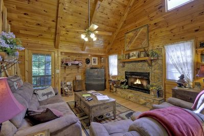 Living Room with a Gas Log Fireplace and two Recliners