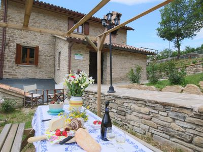 Photo for Farmhouse in the hills, beautiful views, swimming pool and authentic restaurant