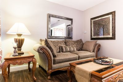 Ample seating is available right off the kitchen in perfect view of the TV.