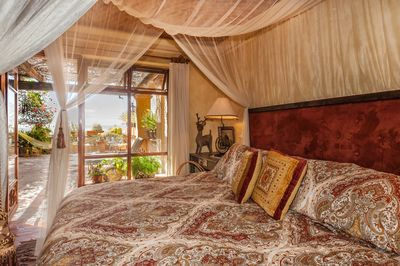 Charming master suite with private entrance, a king bed and gorgeous views.